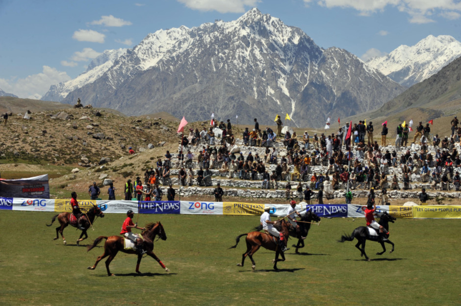 Rival polo teams from Chitral and Gilgit compete during the worlds highest polo match on the Shandur Pass, Chitral, Pakistan.